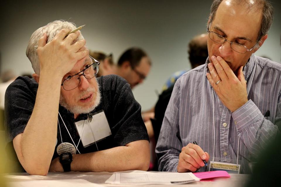 Philip Cohen (left) and game partner Evan Morton worked to solve a puzzle.
